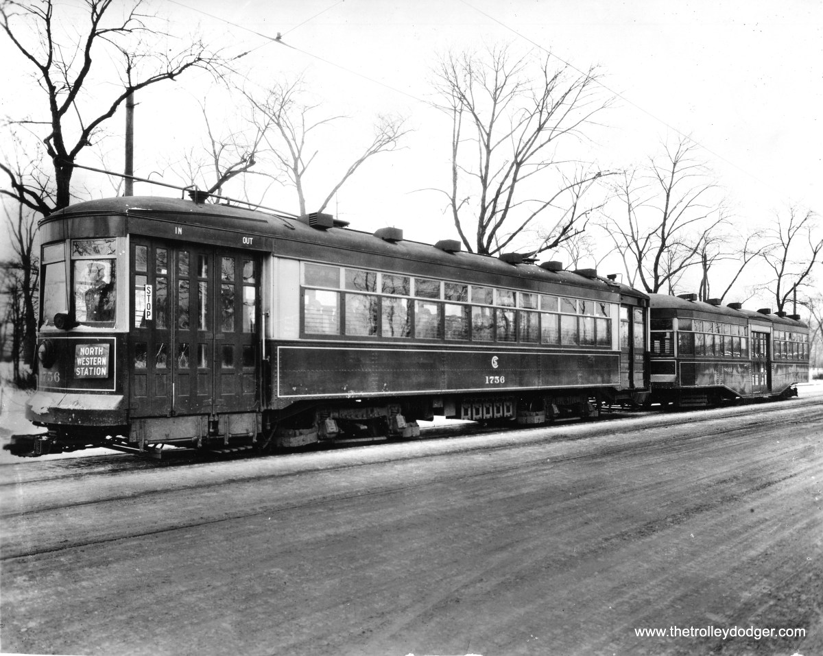 """The Chicago Surface Lines used trailers during the 1920s, as a way of dealing with increasing crowds of riders. But with the advent of the Great Depression, ridership fell sharply, and the trailers were no longer needed. Some thought was given to reviving them during World War II, but this did not happen. Here, 1756 pulls 8049. Don's Rail Photos notes, """"8056 was built by Brill in 1921, #21272. It became a shed at 77th and scrapped on July 17, 1957."""" 1756 was a """"169"""" or Broadway-State car. Again, Don Ross: """"1756 was built by CSL in 1923. It was rebuilt as one-man in 1949."""""""