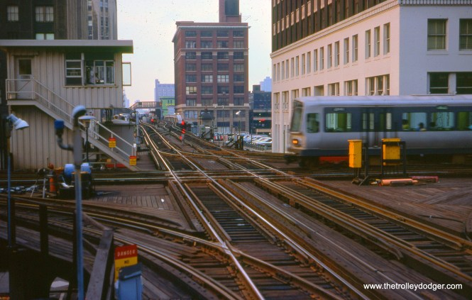 At left, CTA's Tower 18, at the junction of Lake and Wells, on September 13, 1976. The view looks north.