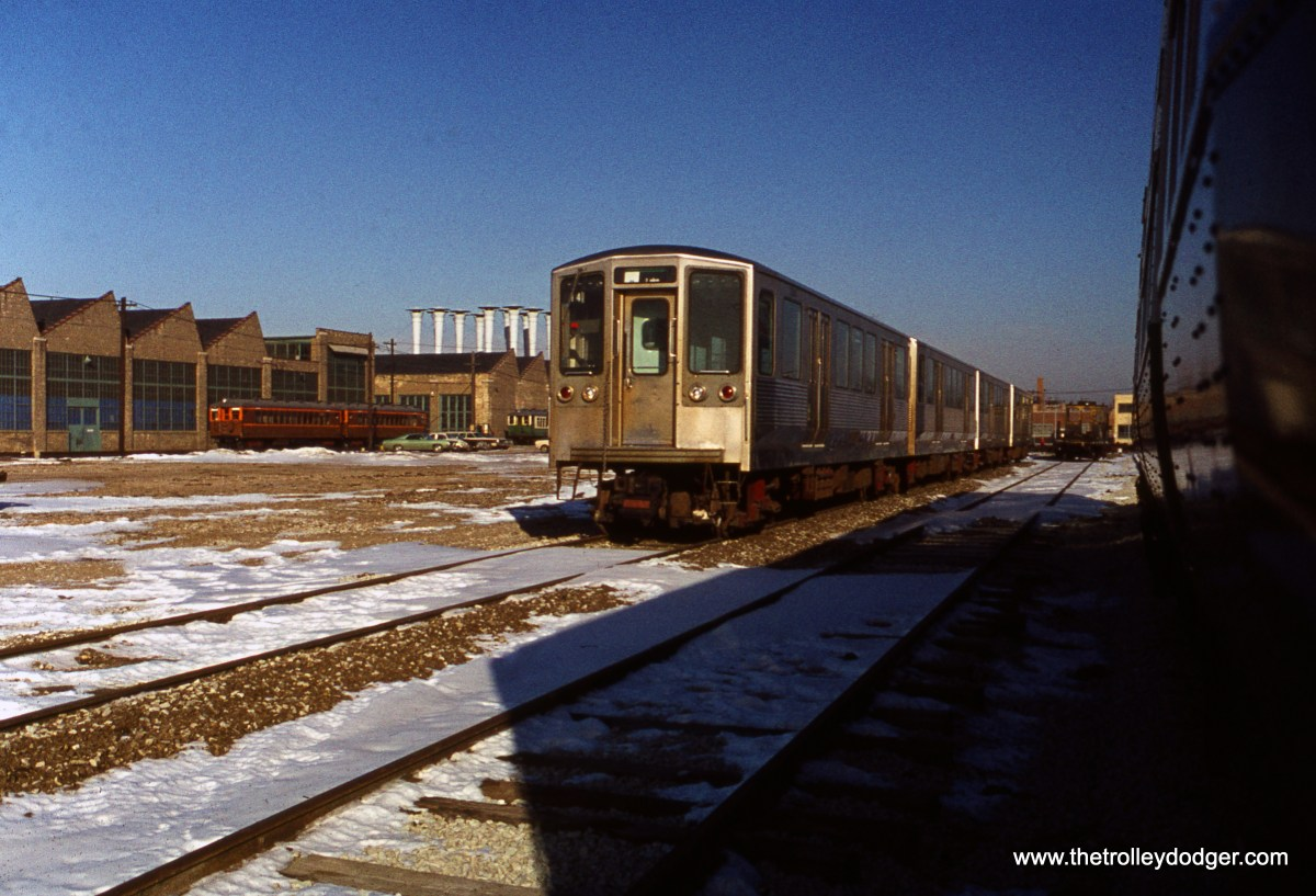 "CTA 2200-series ""L"" cars at Skokie Shops on December 11, 1976."