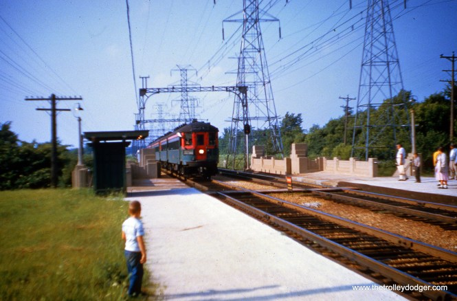 A North Shore Line interurban train, possibly on a fantrip, at the Deerpath station in Lake Forest, Illinois. Photo by Joseph M. Canfield, from the Dave Stanley collection. The boy at left is probably collecting Social Security now.