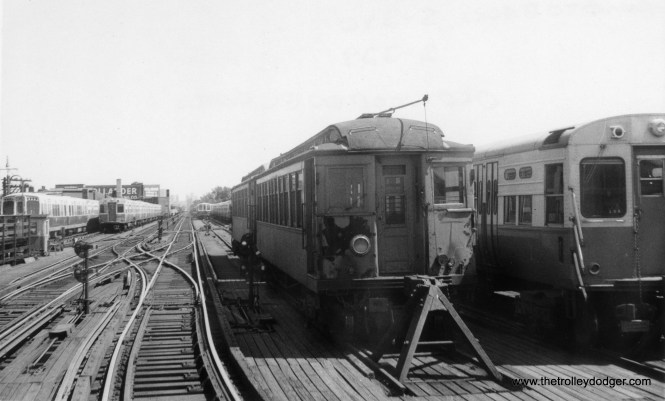 "A pair of CAT wooden ""L"" cars, shown here, survived into the mid-1960s, as shown by this view of the yard at Logan Square, where 6000s and 2000s are in evidence. This dates the picture to sometime between 1964 and 1970. Andre Kristopans: ""The wood work motors at Logan Square hauled the rail grinder sleds until 1965 or so."" Scott Greig: ""Wood ""L"" cars at Logan...there were several wood cars (particularly the 1809-1815 group) that lasted in work service as late as 1968, maybe even 1970. Given that there's no crane or flat cars with them, they may be a rail grinder train."""