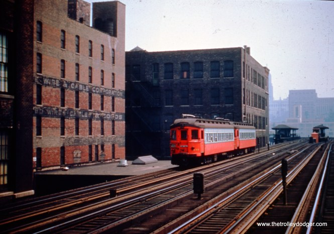 A two-car Chicago Aurora & Elgin train, headed up by 433, is just west of the Canal Street station on the Metropolitan four-track main line in August 1953, a month before CA&E service was cut back to Forest Park. (John Szwajkart Photo)