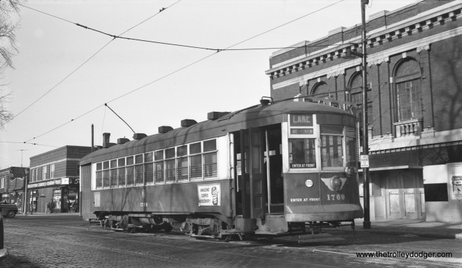 CTA one-man car 1769 (here painted green, not red) is at Lake and Austin, west end of Route 16. The date of this Bob Selle photo is December 19, 1953, one year to the day before I was born. The Park Theater at right appears to already be closed.