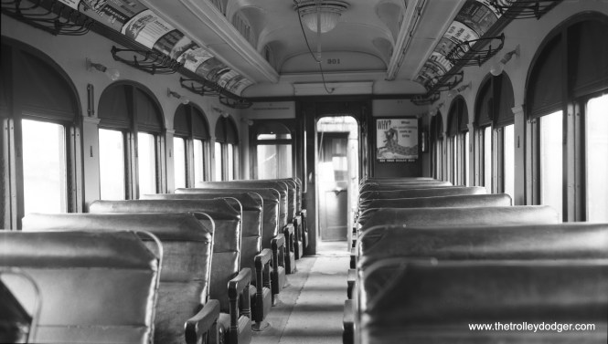 "This is how the interior of Chicago Aurora & Elgin car 301 looked on August 8, 1954, the date of a fantrip for the Central Electric Railfans' Association. Don's Rail Photos: ""301 was built by Niles Car & Mfg Co in 1906. It was modernized in December 1940."" (Robert Selle Photo)"