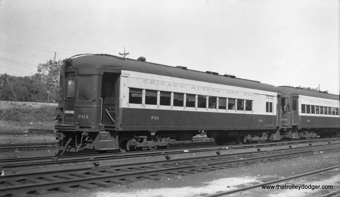"CA&E car 701, ex-Washington, Baltimore & Annapolis. Don's Rail Photos: ""701 was built by Cincinnati Car Co in 1913 as WB&A 81. It was sold as CA&E 701 in 1938."" Don also notes, ""In 1937, the CA&E needed additional equipment. Much was available, but most of the cars suffered from extended lack of maintenance. Finally, 5 coaches were found on the Washington Baltimore & Annapolis which were just the ticket. 35 thru 39, built by Cincinnati Car in 1913, were purchased and remodeled for service as 600 thru 604. The ends were narrowed for service on the El. They had been motors, but came out as control trailers. Other modifications included drawbars, control, etc. A new paint scheme was devised. Blue and grey with red trim and tan roof was adopted from several selections. They entered service between July and October in 1937."""