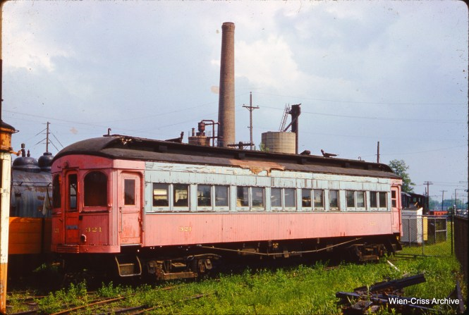 Looking somewhat worse for wear, here is CA&E car 321 as it looked at the Illinois Electric Railway Museum in North Chicago on June 9, 1962. This and the other cars that were saved from the line had been stored outdoors for a few years, and exposure to the elements took their toll. The museum, now just IRM, moved to Union in 1964. (Wien-Criss Archive Photo)
