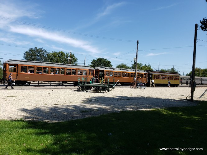 "A three car wooden ""L"" train, made up of Chicago cars 1268, 1797, and newly restored 24 (formerly 1024)."