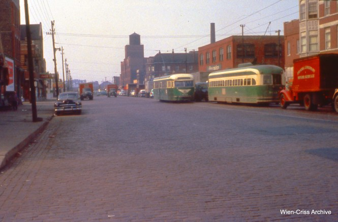 CTA prewar PCC 4027 (at left) passes a postwar car on Western at 24th on June 7, 1956. (Wien-Criss Archive)
