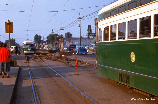 CTA 7042, in the distance, is about to clear a temporary switch so that the car on the right can cross over to that side during track work. This picture was taken on June 17, 1955 at Western and 71st. (Wien-Criss Archive)
