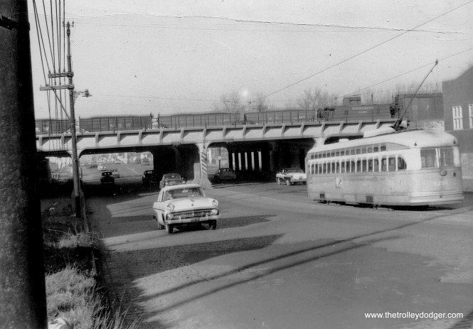 This picture was taken on November 24, 1955, at Western Avenue and 75th, with a PCC heading north, about to go under the Belt Railway of Chicago. A mid-50s Ford heads south. (William Shapotkin Collection)