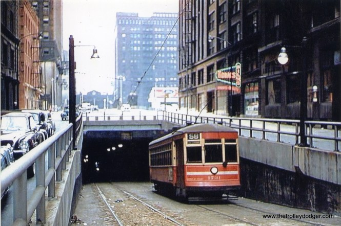 A westbound CTA Route 58 - Ogden streetcar descends into the Washington Street tunnel circa 1950, about to head under the Chicago River. (William Shapotkin Collection)