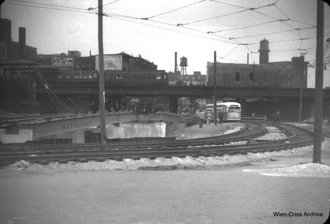 "This is, for me, a very interesting photo. It shows construction of the new Halsted Street bridge that will eventually go over the Congress (now Eisenhower) Expressway under construction on May 20, 1951. As you can see, the bridges were built first, before the area around them was excavated. That way, traffic could be diverted around the construction site as it is here. There was a shoo-fly for streetcars and a temporary roadway for other traffic. The view looks north. The nearby ""L"" station remained in service until 1958, although two of the four tracks were removed. (William C. Hoffman Photo, Wien-Criss Archive)"