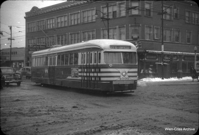 "Eastbound prewar PCC 4030, in ""tiger stripes,"" crosses Western Avenue on 63rd Street on November 26, 1950. (William C. Hoffman Photo, Wien-Criss Archive)"