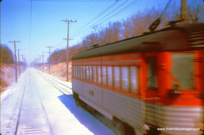 NSL 776 (train 409) passes train 409 at speed north of Racine on January 16, 1963. (John D. Horachek Photo, William Shapotkin Collection)