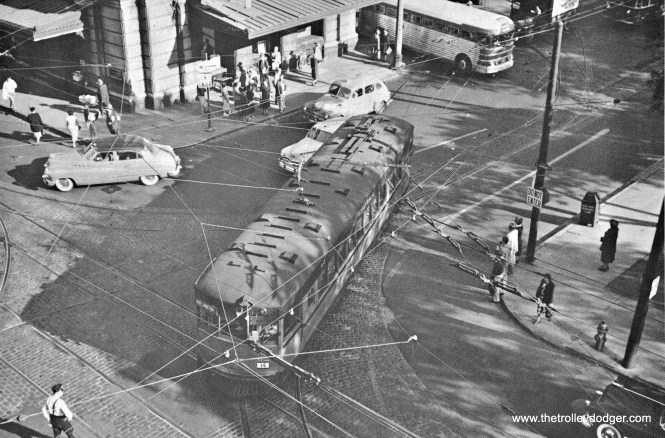 60 SERIES AND GREYHOUND SILVER SIDES @ 3RD AND MICHIGAN The Medford Hotel on the NW corner of 3rd & Michigan (long gone) was the perfect place to watch activity at the PSB. Look at this.