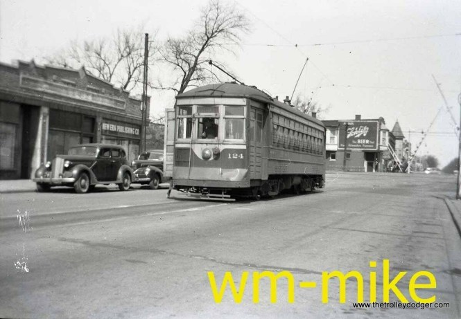 """Not sure where this picture of C&WT 124 was taken... Maywood? Or could this be Madison Street in Forest Park? Bill Shapotkin adds: """"This photo was taken in Maywood. The car is in 19th Ave and the west end of the Madison St Line. The Grade crossing in the background is the C&NW-IHB (the """"Melrose Park"""" C&NW station would be located to right). View looks north."""""""