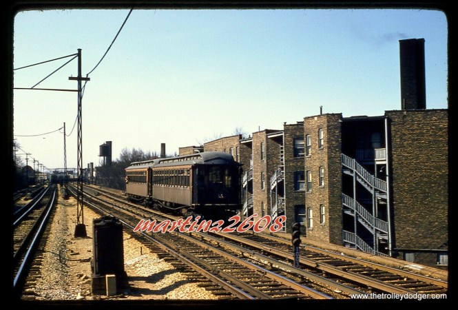 """A two-car CTA wooden """"L"""" train on April 13, 1957. I would expect that we are not too far south of Howard Street."""