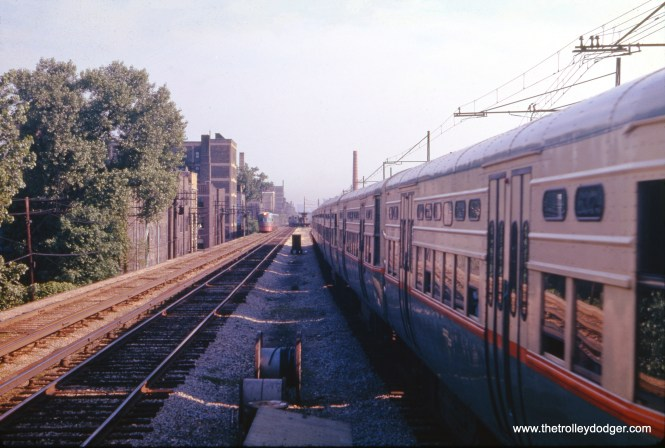 In June 1961, photographer J. W. Vigrass captured this shot of a southbound Howard train at right, with a North Shore Line Electroliner heading north at left, and a northbound Howard train at center. Overhead wire is visible on the fourth track, for use by freight trains that were operated by the CTA until 1973. Southbound North Shore trains also used this power source at times.