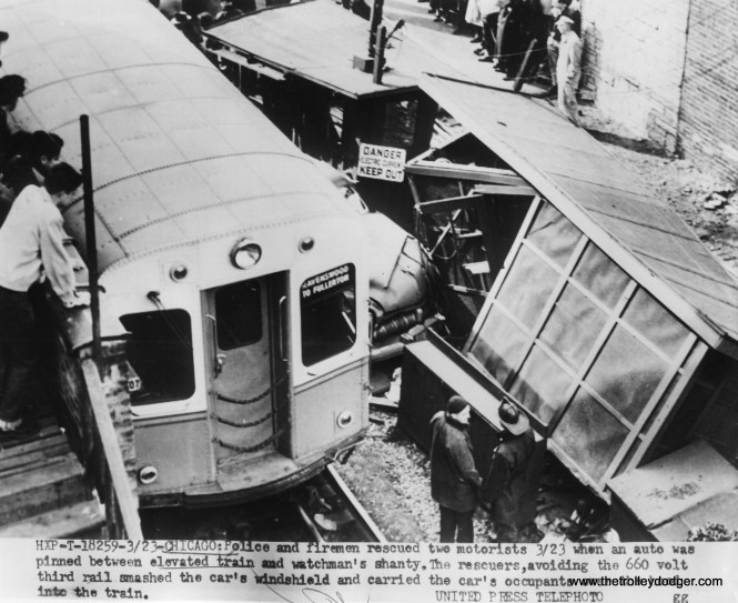 """The date on the back of this photo is April 1, 1953, although the date in the caption is March 23, which was a Monday. I am not sure just which station this was near, along the ground-level portion of the CTA Ravenswood (now Brown Line) """"L"""". This train was only going as far as Fullerton, which suggests this accident may have happened at night, at a time when Ravenswood trains did not go all the way to the Loop. (The turnback point for this was later moved to Belmont.)"""