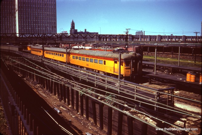 A South Shore Line train, including car 102, is at the Randolph Street Terminal on July 2, 1961. This area has been completely transformed. The station is now underground, underneath Millennium Park.