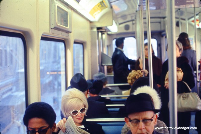 The woman with the sunglasses has an interesting hairdo.