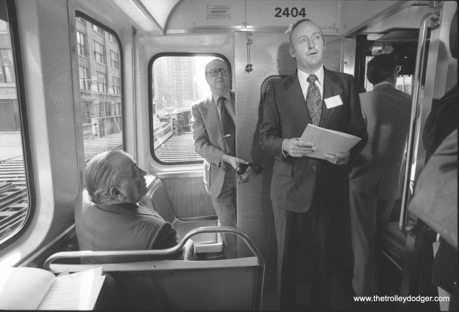 This, and the next few pictures that follow, show Chicago Mayor Richard J. Daley (1902-1976) taking part in the ceremonial introduction of the then-new CTA 2400-series rapid transit cars. The man behind the door is George Krambles, who eventually became general manager of the CTA. Not sure who the other gent is. Daley was then 74 years old and had been mayor for 21 years. He doesn't look particularly well, and in fact died from a massive heart attack later in the year, while he was at his doctor's office for a check-up. This series of cars was retired a few years ago, although some have been retained for work service, and for the CTA's historic collection. They are available for charters.