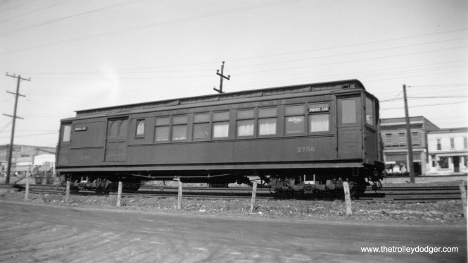 2756 was a Met, car built in 1895, that at some point was converted for use as a medical car, and traveled over the Insull properties whenever it was necessary to give physical exams. Here, we see it on the Cross Street team track in Wheaton. Since the car did not have trolley poles, when it went on the North Shore Line, it had to be towed by something else, like a box motor car.