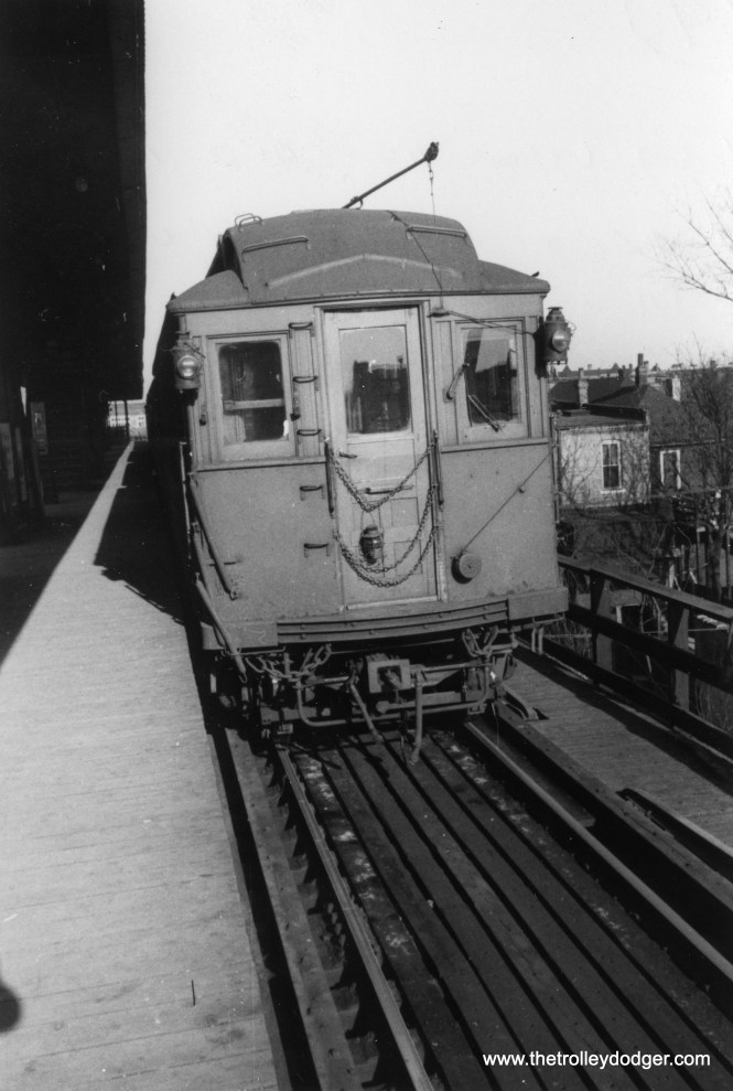 "Here, a former Lake Street ""L"" car heads up a Stockyards shuttle train at Indiana Avenue on April 11, 1954."