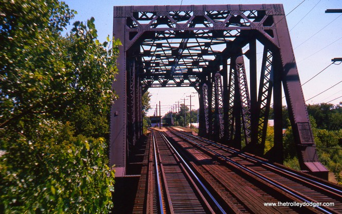 This is the bridge over the North Shore Channel on the Evanston route in August 1963. We are looking south, and the station in the distance is Central Street.