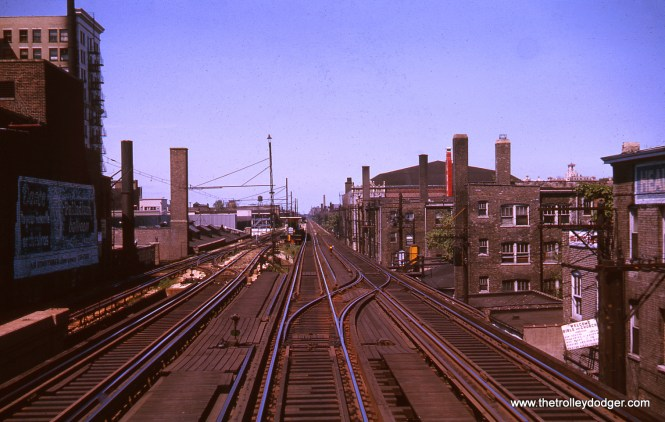 This August 1963 view is just south of Lawrence, looking north. The overhead wire at left was used by CTA electric locomotives, a holdover from the days when the Milwaukee Road had service here, prior to this line being electrified and put up on an embankment. Apparently, North Shore Line trains sometimes used the overhead and switched over to third rail further south.