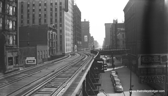 "Caption: ""Chicago El showing curve at Harrison and Wabash, taken from Congress Street station, April 2, 1939."" This curve has since been straightened out. The view looks south. (Duncan L. Bryant Photo)"