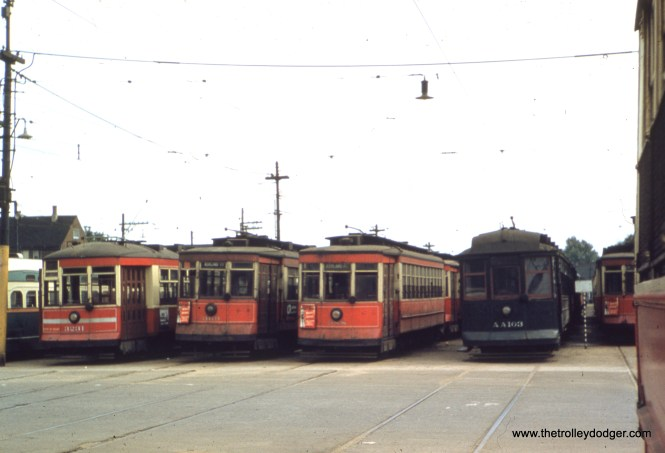 "CTA 3231, 369, 988, and AA103 at 69th and Ashland in May 1949. M.E.: ""The Green Hornet PCC in this picture would have been assigned to Western Ave. When the 69th/Ashland barn closed, but Western still operated PCC streetcars, those cars were moved to the 77th and Vincennes barn. To get there, they traveled east on 69th St. to Wentworth, south to 73rd, then southwest on Vincennes to 77th St."""