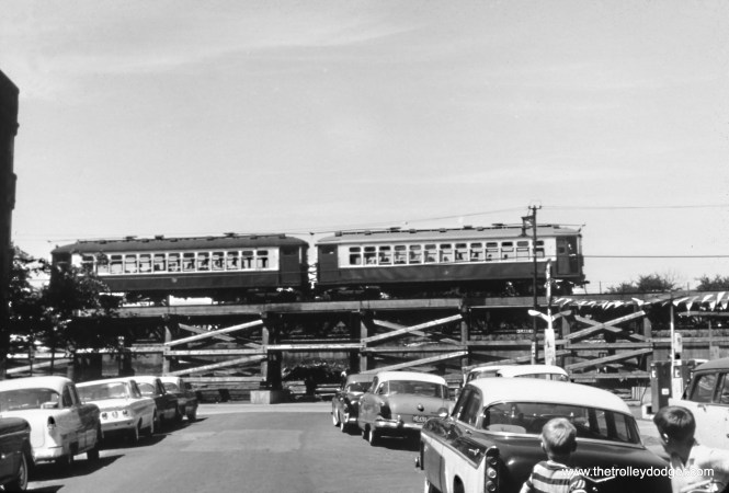 "The Lake Street ""L"" ramp between Central Avenue and Laramie circa 1961-62. This was after the changeover point between third rail and overhead wire was moved west of here. I think this picture was taken looking north on Latrobe."