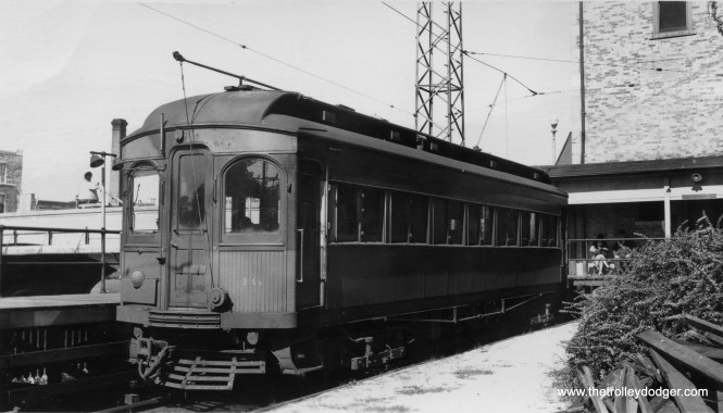 "Chicago Aurora & Elgin wood car 16 at the end of the Batavia branch. Don's Rail Photos: ""16 was built by Niles Car in 1902. It was modernized in December 1939 and retired in 1959."""