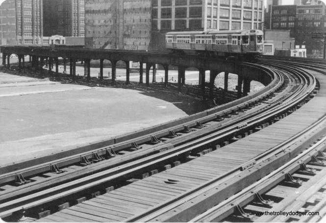 "Looking northeast from the Halsted station on the Met ""L"" main line on June 27, 1954, we see a two-car westbound Garfield Park train of flat-door 6000s."
