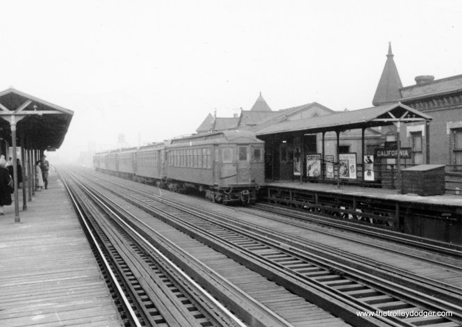 "A six-car train of wooden ""L"" cars heads west at California Avenue on the Lake Street line. We are looking west on March 17, 1954."