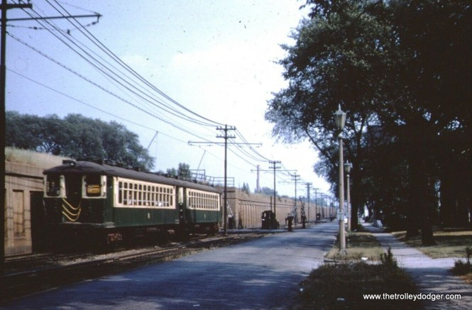 """A westbound Lake Street """"A"""" train, when the outer portion of that line ran at ground level west of Laramie. This is somewhere in Oak Park, perhaps between Home Avenue and Kenilworth."""