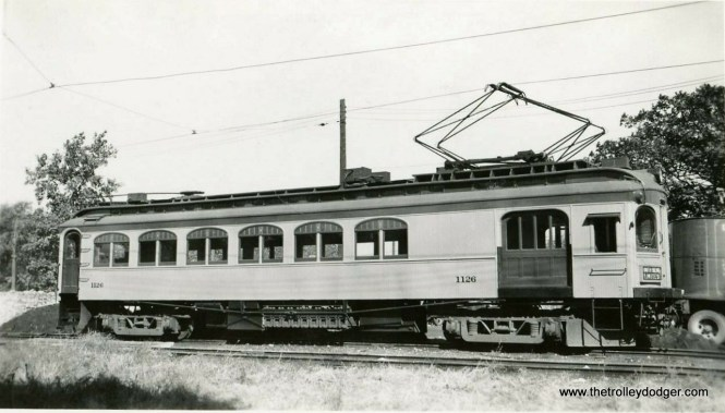 "Don's Rail Photos: ""South Shore Line 1126 was a work motor built by Niles in 1908 as CLS&SB 73. In 1927 it was rebuilt into work motor 1126. In 1941 it was sold and converted to a house. In 1994 it was purchased for restoration from a buyer who had picked it up the month before for back taxes. He really did not want the car, just the land. Bob Harris began restoration in 2005."" The sign says South Bend Limited."
