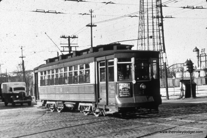 CTA 214 on Belmont at Western Avenue, with Riverview amusement park in the background. The tall structure is the parachute jump. I rode that once (the park closed after the 1967 season). This picture was taken on December 31, 1948.