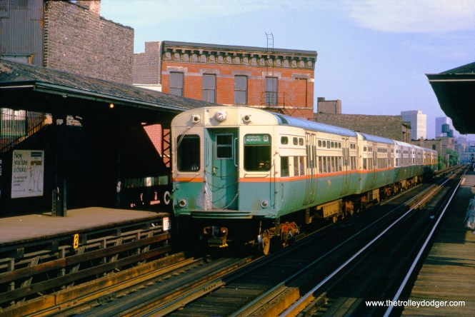 "This is a beautiful shot, showing a six-car CTA train of 6000s heading northwest on the Logan Square ""L"" at Damen Avenue on August 21, 1970. The photographer identified the first four cars as 6629-30 and 6657-58. Sometimes the angles work out just right."