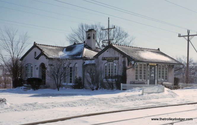 CNS&M Glenayre passenger station in Glenview, Illinois. This slide was taken on January 24, 1963 three days after the North Shore abandoned service. It is one of nine Mediterranean Revival Style built by Samuel Insull. Only two still exist: Beverly Shores on the South Shore Line and Briergate on the North Shore Line.