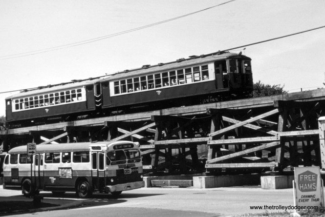 "CTA 1608-4000 Series L cars (this is where the Lake Street ""L"" descended to ground level, just west of Laramie, which it did until October 1962)."