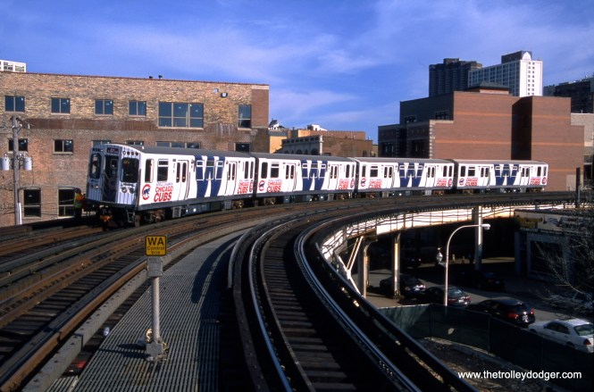 Jeff Wien was, in large part, responsible for a fantrip on February 19, 2017, where four CTA rapid transit cars were posed at various places on the system for photo stops, wrapped to celebrate the first Cubs World Series championship since 1908. I purchased this original slide on the very day he died, with the intention of giving it to him on his upcoming 80th birthday. It is also an excellent example of the type of shot he excelled at himself-- a 3/4 view in sunlight. (Bruce C. Nelson Photo)