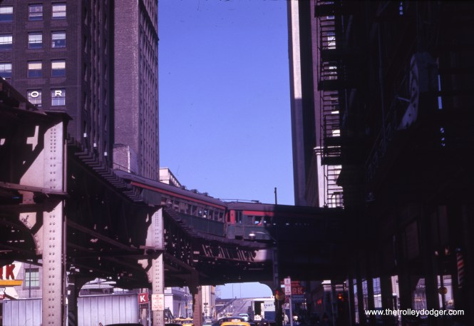 "A northbound North Shore Line train rounds the curve at Lake and Wabash in June 1961. We are looking to the east. This is an early Kodachrome II slide. The film had a faster ISO than the original Kodachrome, and was said to be sharper, with a thinner emulsion. But not all photographers were happy about the change, and it had a bit less contrast, and some missed the ""Rembrandt blacks"" of the old version. (J. William Vigrass Photo)"
