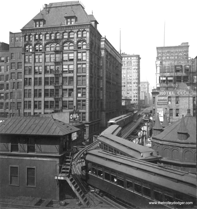 "I spent some time cleaning up this image, which was part of a stereo pair meant to be viewed in 3-D using a handheld device called a ""stereopticon."" It shows Chicago's Loop ""L"" circa 1905, and this is the original left-hand running, bi-directional configuration, before it was changed in 1913. So the train at right is moving towards us, while the train at left is moving away from us. The view looks west along Van Buren Street, and that is the old Tower 12 at left. A Metropolitan ""L"" train is on the inner Loop, while a Lake Street train trails a Northwestern ""L"" train on the outer Loop. At this stage, only the Lake trains would have needed trolley poles. The station at Van Buren and State is visible in the distance."