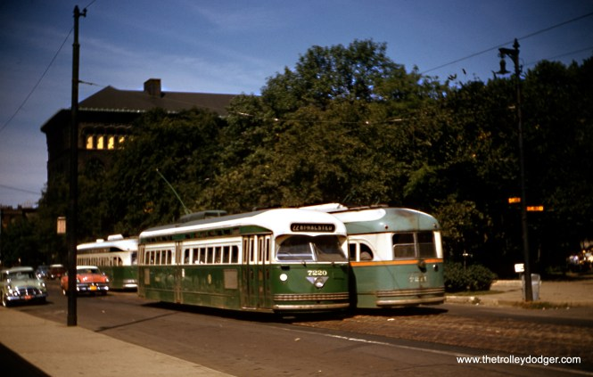 "In September 1957, CTA PCCs 7220 and 7211 pass each other on Clark Street at Delaware near the Newberry Library and Washington Square Park, also known locally as ""Bughouse Square."" A version of this image, taken from a duplicate slide, appears on page 181 of B-146, mistakenly attributed to Charles L. Tauscher. (Robert Heinlein Photo)"