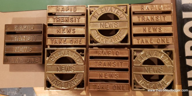 "Leaflet holders from 4000-series ""L"" cars. The Elevated News was published by the Chicago Elevated Railways Collateral Trust, formed in 1913 as a voluntary association by the four independent (or at least they started that way) ""L"" firms. The 4000-series, which eventually ran to 455 cars, was the first designed for use on all the various ""L"" lines. The title of their rider publication was changed to Rapid Transit News in 1924, coincident with the formation of the Chicago Rapid Transit Company. The Chicago Transit Authority had its own publication, the Rider's Reader, for a few years starting in 1948."