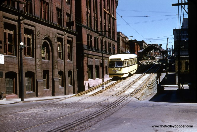 "There were a few cities besides New York, Chicago, Boston, and Philadelphia to have some sort of elevated electric railways, and Kansas City was among them. Here, Kansas City Public Service car 785 is descending from the 8th Street ""L"" at Baltimore Avenue on September 3, 1952. I was fortunate to win this original Red Border Kodachrome slide, because I had lost an auction for it once before when someone sold it. Kansas City abandoned streetcars in 1957, but has since reopened a modern streetcar line. (Edward S. Miller Photo)"