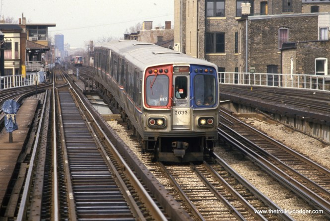 A southbound CTA Englewood train (lead car: 2033) has met a northbound Howard train at Armitage station in April 1985, and is descending into the State Street Subway. (William Shapotkin Collection)