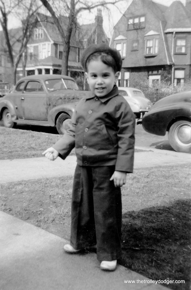 "Mom wrote: ""May 1944. My new outfit-- navy overalls and red jacket and beret. Mama likes to dress me in red-- the better to keep her eyes on me."""